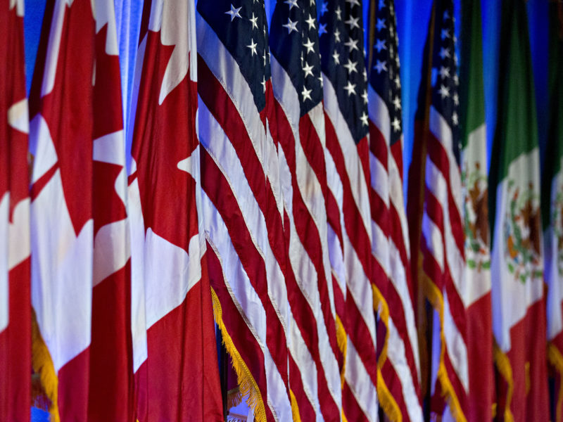 Canadian, American and Mexican flags stand on stage ahead of a North American Free Trade Agreement (NAFTA) renegotiation in Washington, D.C., U.S.