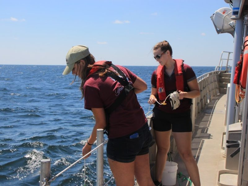Victoria Scriven and a fellow oceanography student conduct field work on a cruise aboard the R/V Manta, a NOAA vessel.