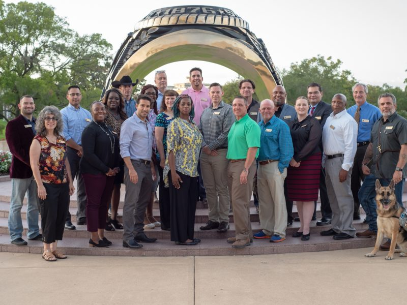 Members of the 2018 Entrepreneurship Bootcamp For Veterans class gather at the Haynes Ring Plaza.