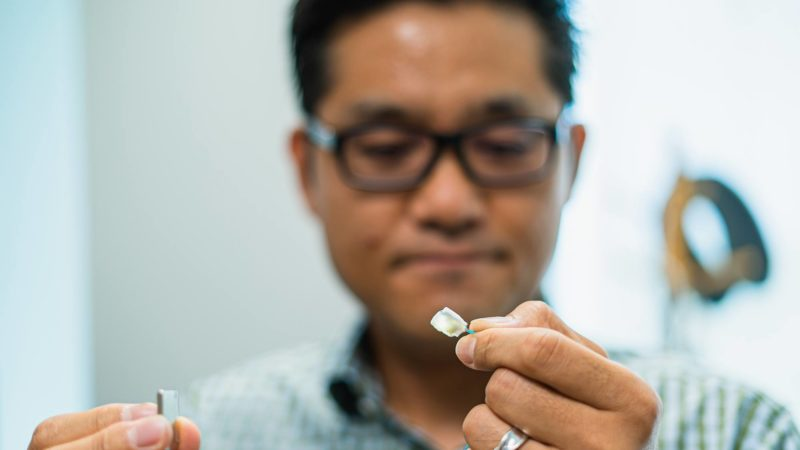 Texas A&M University assistant professor Sung Il Park holds the wireless surgical lighting device he developed.