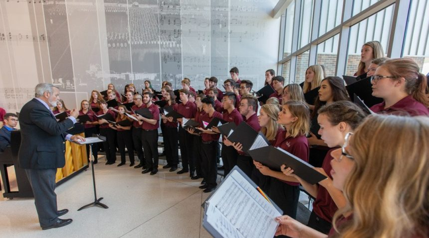 Choral students sing in in the lobby of the Music Activities Center