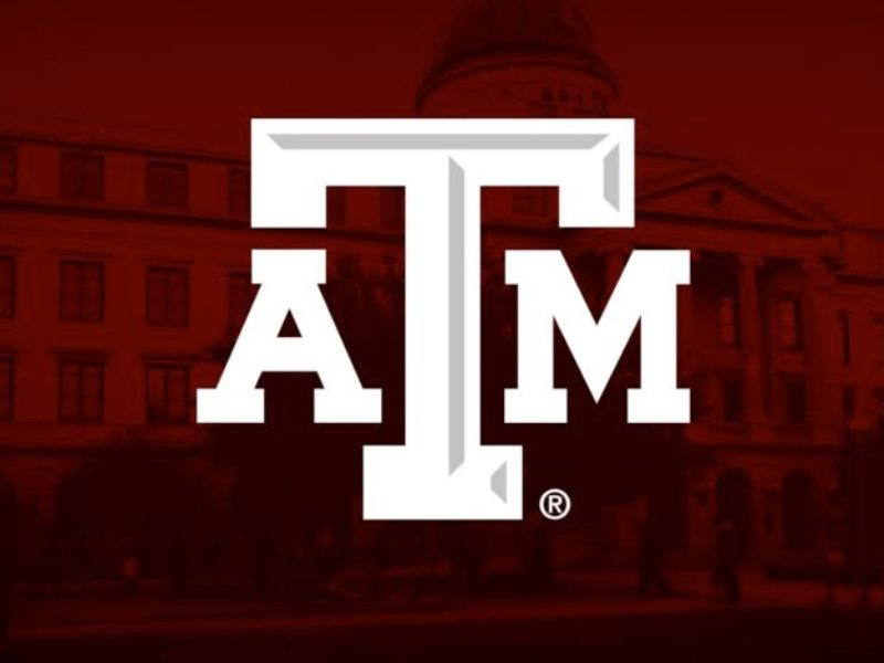 Texas A&M Logo in front of Academic Building