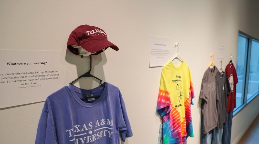 T-shirts and a cap hang on a wall
