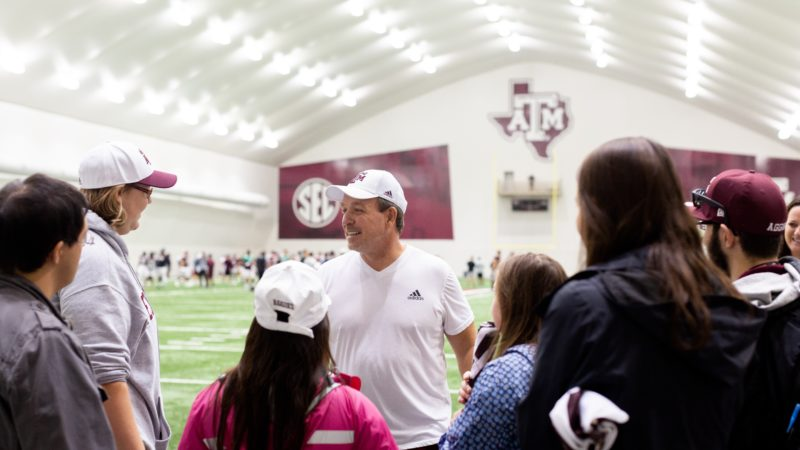 Jimbo Fisher talking to Aggie ACHIEVE students at football practice facility
