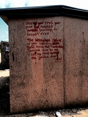 Words inscribed on the Statue of Liberty were found written on the side of a shack in one of the refugee camps Batarse and Main visited.