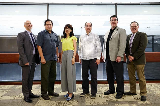 From left: Ira Dworkin, an assistant professor in the Department of English; Diego von Vacano, an associate professor in the Department of Political Science; Jun Lei, an assistant professor in the Department of International Studies; Martin P. Regan, an associate professor and associate head of the Department of Performance Studies; Jeffrey M. Morris, an associate professor in the Department of Performance Studies; and Adam R. Seipp, a professor in the Department of History. Angela P. Hudson, an associate professor in the Department of History, did not attend the ceremony.