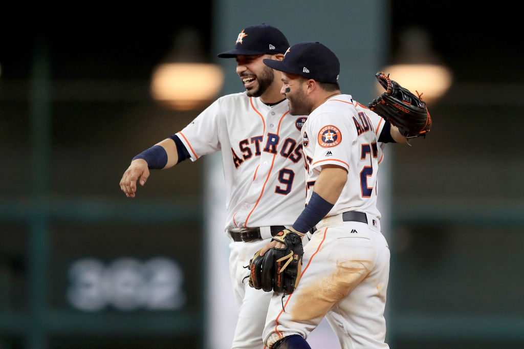 ose Altuve #27 of the Houston Astros celebrates with Marwin Gonzalez #9 after defeating the New York Yankees by a score of 4-0 to win Game Seven of the American League Championship Series at Minute Maid Park on October 21, 2017 in Houston, Texas. The Houston Astros advance to face the Los Angeles Dodgers in the World Series. (Photo by Ronald Martinez/Getty Images)