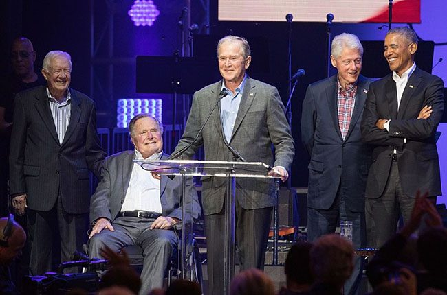 OCTOBER 21: (L-R) Former United States Presidents Jimmy Carter, George H.W. Bush, George W. Bush, Bill Clinton, and Barack Obama address the audience during the 'Deep from the Heart: The One America Appeal Concert' at Reed Arena on the campus of Texas A&M University on October 21, 2017 in College Station, Texas.