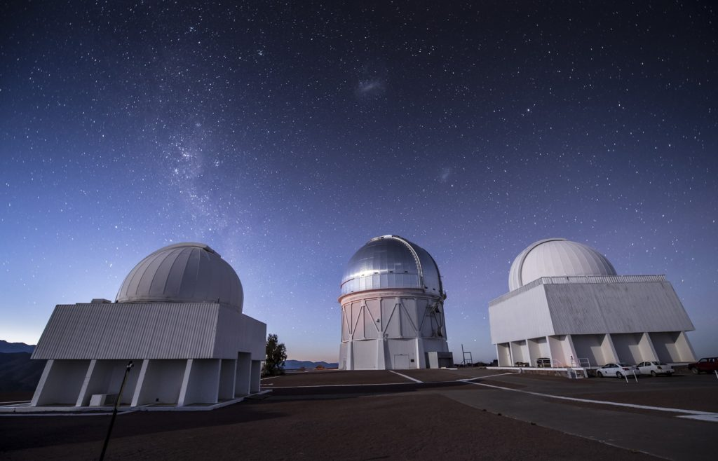 Starry skies over Cerro Tololo Inter-American Observatory in Chile and the 4-meter Victor M. Blano Telescope (center), home to the 570-megapixel Dark Energy Camera and unprecedented discovery potential for astronomers at Texas A&M University and around the world as members of the Dark Energy Survey. (Credit: Fermilab.)