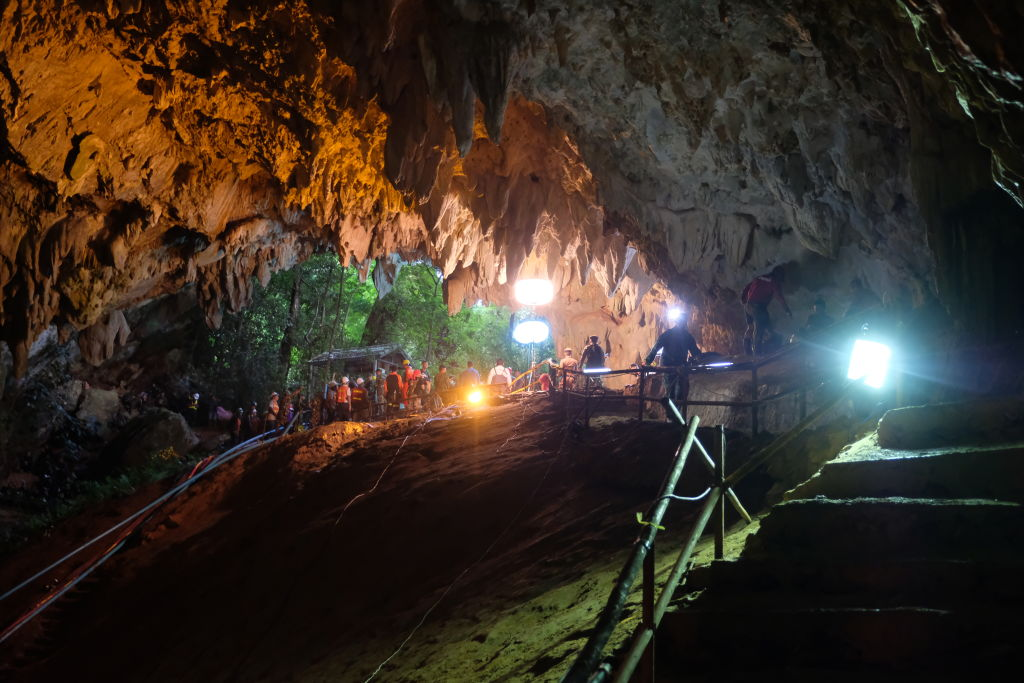 Rescuers install a water pump inside Tham Luang Nang Non cave on June 28, 2018 in Chiang Rai, Thailand. Rescuers battle heavy rain in northern Thailand as they continued the search for 12 boys and their soccer coach who have been missing in Tham Luang Nang Non cave since Saturday night after monsoon rains blocked the main entrance. Teams of Navy SEAL divers worked their way through submerged passageways in the sprawling underground caverns as senior Thai government officials warned on Wednesday that time is running out and the search intensifies for the young soccer team, aged between 11 to 16, and their their 25-year-old coach, with soldiers and park rangers seeking other entry points into the cave system.  (Linh Pham/Getty Images)