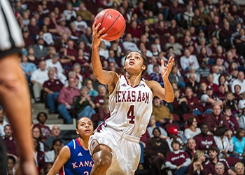 Texas A&M Guard Sydney Carter drives to the rim for a layup against Kansas in 2011. (Flickr)